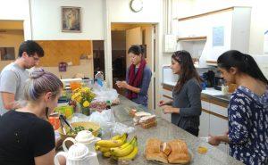 homeless college students volunteers making dinner